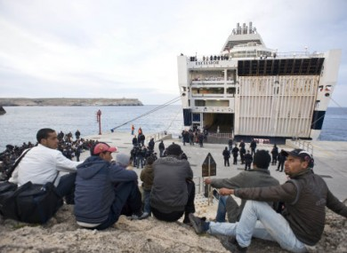Migrants pictured waiting for a ferry in Lampedusa this morning. This boat is not the boat that sank.
