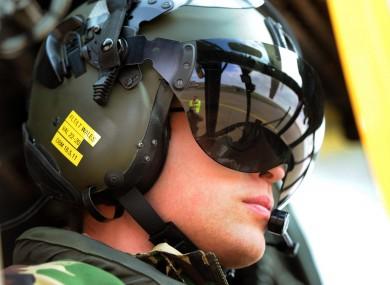 Prince William at the controls of a Sea King helicopter during a training exercise at Holyhead Mountain yesterday.