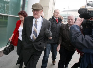 Kevin Crilly (centre) leaving Belfast Crown Court earlier today after his acquittal.