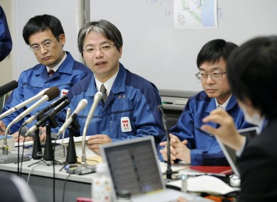 TEPCO staff are questioned by a reporter during a press conference at the company's headquarters in Tokyo.