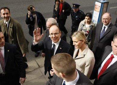 Prince Albert of Monaco II and his fiancee Charlene Wittstock (centre) leave the National Museum of Dublin at the start of a two-day state visit to Ireland.