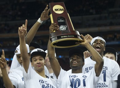 Kemba Walker (centre) holds up the championship trophy with his Connecticut teammates.