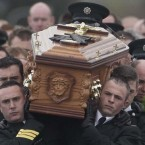 The coffin of PSNI Constable Ronan Kerr is carried through his home town of Beragh in Co Tyrone, to the Church of the Immaculate Conception.