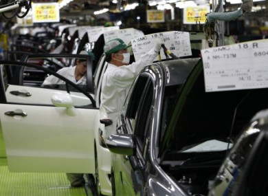 Workers at a Honda plant in Sayama, north of Tokyo, on 18 April, 2011.