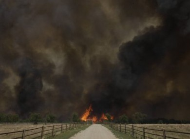 Smoke rises from an uncontrolled wildfire burning near Possum Kingdom, Texas.