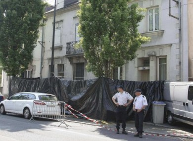 French police officers stand outside the house of a French family missing since May, today.