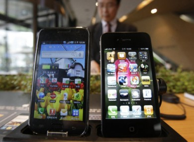 Samsung's Galaxy S (left) displayed alongside Apple's iPhone 4.