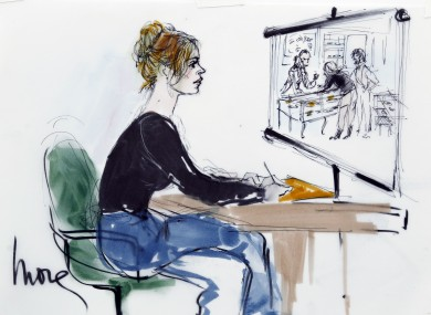 A courtroom sketch depicts Lindsay Lohan being shown CCTV footage of her alleged necklace theft.