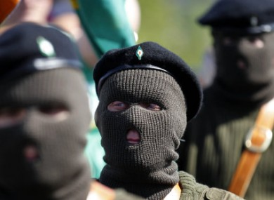 Masked members of the Real IRA at a 1916 Easter Rising commemoration yesterday.