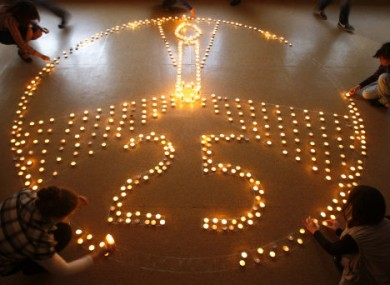 Pupils and teachers at a school in Minsk, Belarus, light candles in memory of the victims of the Chernobyl disaster in 1986.