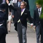 Elton John and husband David Furnish arrive.