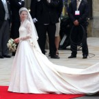 It's mercifully not as long as Diana's but Kate did decide to go for the traditional train and veil combo.