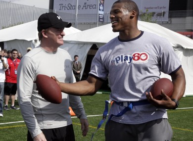 NFL draft prospect Cam Newton, right, and Commissioner Roger Goodell at the pre-draft event in New York yesterday.