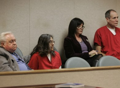 Phillip Garrido (right) and his wife Nancy (second from left), pictured with their attorneys