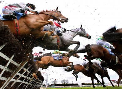 Runners and riders crash through the hurdles at Fairyhouse yesterday.