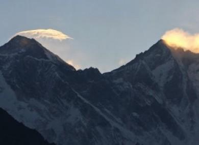 Clouds hover above the world's highest peak, Mount Everest.
