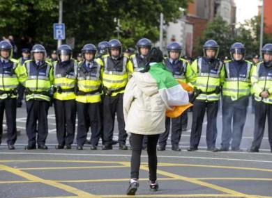 A protesters confronts gardaí at Christchurch in Dublin yesterday.