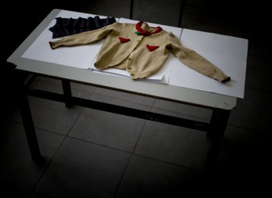 A jumper belonging to an eight year old Holocaust victim named Gitel is displayed on a table after being donated by family members to the Yad Vashem Holocaust Memorial.