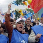 People shout slogans as United Russia party and government-linked trade unions took to the streets to mark May Day in Moscow, Russia. (AP Photo/Mikhail Metzel)