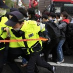 Workers and students struggle with police officers as they try to march after a May Day rally at downtown of Seoul, South Korea. (AP Photo/Lee Jin-man)