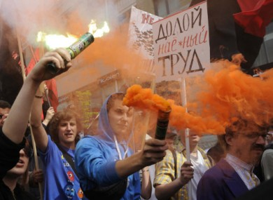 Left wing activists shout slogans during a rally marking May Day in Kiev, Ukraine, today.