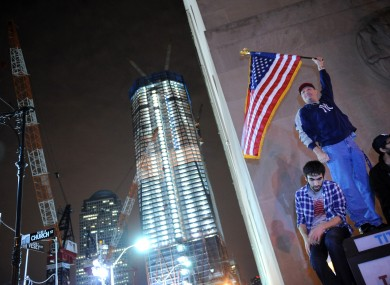 Citizens of New York City celebrate the death of Osama bin Laden, in front of the building site of the new One World Trade Centre building.