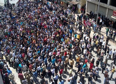 Syrian anti-government protesters gather in the coastal town of Banias on Friday.