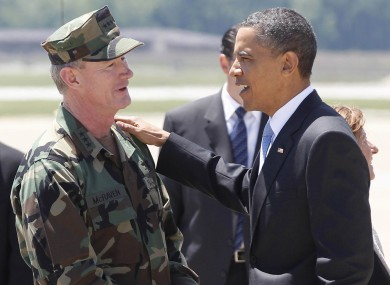 PreBarack Obama talks with US Navy Vice Admiral William H. McRaven who had operational control of the mission to get Bin Laden