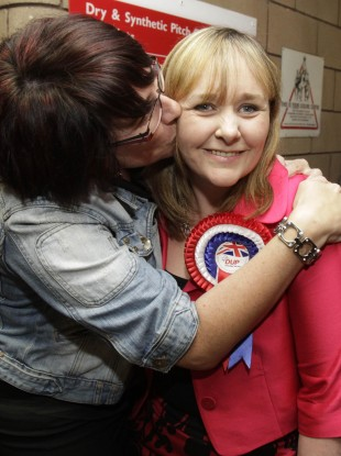 Michelle McIlveen of the DUP who topped the poll in the Strangford constituency is kissed by a supporter.