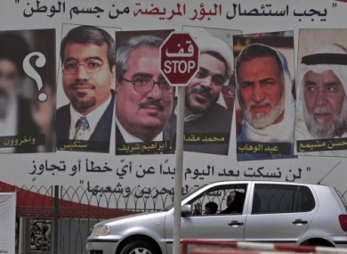 Pro-government posters with images of jailed opposition leaders bearing a sign saying: