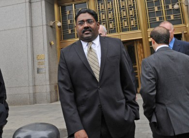Raj Rajaratnam leaves court in Manhattan after being found guilty of 14 counts.