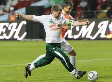 Alessandro Costacurta tries to dispossess Chechen leader Ramzan Kadyrov during last night's game.