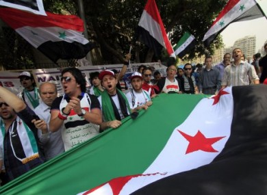 Syrian protesters demonstrate in Egypt against Assad's rule.