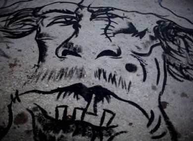 Graffiti depicting Col Gaddafi as a beast seen downtown in Benghazi, Libya, on 16 May 2011.