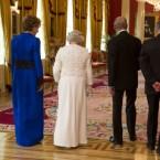 President McAleese walks through Dublin Castle with Queen Elizabeth, the Duke of Edinburgh and Dr McAleese. (Mark Cuthbert/UK Press/PA)