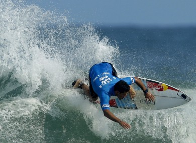 Adriano de Souza of Brazil competes in the final round of the Billabong Rio Pro men's surfing competition in Rio de Janeiro.