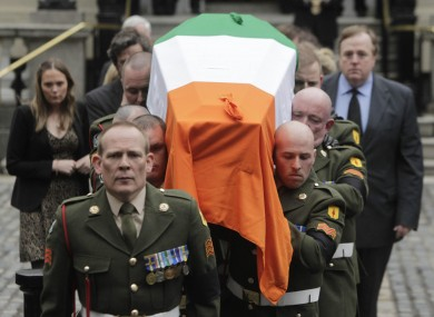Garret FitzGerald's coffin is taken from Mansion House yesterday evening after thousands had turned out to pay their respects to him.