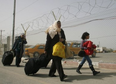 Photo dated 19 February 2011 of Palestinians coming back to Gaza from Egypt at the Rafah crossing.