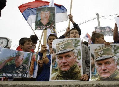 Bosnian Serbs hold Serbian flags and photos of Ratko Mladic during a protest today against his extradition in Kalinovik, Bosnia.