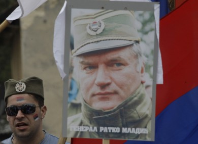 A Bosnian Serb man holds a photo of Mladic during a protest against his arrest in the general's hometown of Kalinovik