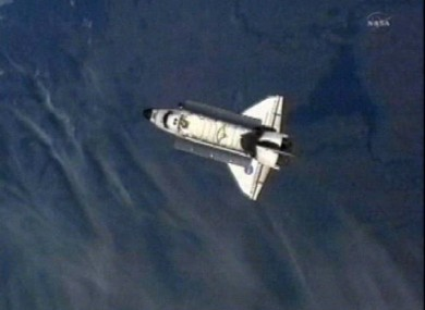 A shot from the International Space Station shows Endeavour heading back towards Earth on its final ever mission.