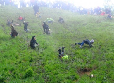 Competitors participating in yesterday's Cheese Rolling.