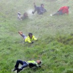 Ouch... Competitors take part in Cheese-Rolling on Coopers Hill, Gloucestershire today after the official event was cancelled. (Pic: Tim Ireland/PA Wire)