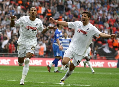 Swansea City's Scott Sinclair (left) celebrates with team-mate Fabio Borini (right) after scoring his hat-trick and his team's fourth goal