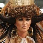 Model Ciara McStravick from Lisburn in an outfit entitled 'tribal' competes in the Fantasy section of the OMC European Hairdressing Championships 2011 at the RDS in Dublin today. (Niall Carson/PA Wire)