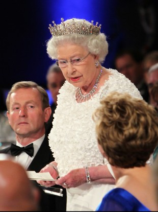 Queen Elizabeth speaks in Dublin Castle this evening, watched by Taoiseach Enda Kenny (left) and President Mary McAleese (right).