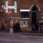 Nationalist youths throw stones on the Falls Road in Belfast on the eve of Bobby Sands' funeral, 1981. Pic: Photocall Ireland