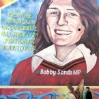 A woman passes a wall mural of Bobby Sands in west Belfast in 2006. Pic: AP Photo/Peter Morrison