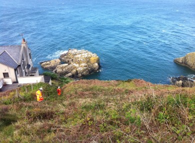 Howth Coast Guard rescuers descend 'the Nose' on Howth Head to reach the walker yesterday