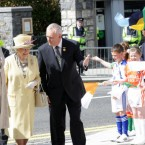 Queen Elizabeth II, President Mary McAleese and GAA President Christy Cooney arrive at Croke Park to the cheers of children in their county colours. (Pic: Maxwells)